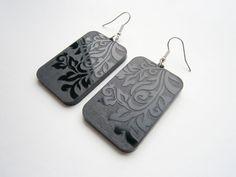 Black Earrings - Engraved Ornament On Both Sides- Lasercut Rectange Earrings  https://www.etsy.com/listing/101456796/black-earrings-engraved-ornament-on-both