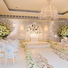 Lush, white floral and plush carpeting are the stars of this stunning wedding at The Dorchester. | WedLuxe Magazine | #wedding #luxury #weddinginspiration #luxurywedding #decor #design #floral #ceremony #floralarrangements #flowers
