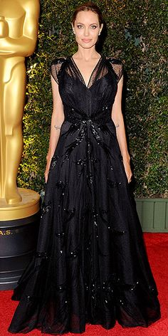 How many times has Angelina worn a black gown on the red carpet? Probably like 100. But this lace Atelier Versace design featuring Swarovski crystal embellishments, a full skirt and sheer cap-sleeves might be her best one yet. http://www.people.com/people/package/gallery/0,,20755963_20756165,00.html