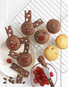 Rudolph Cupcakes! Love these - cupcakes with chocolate icing, raisins for eyes, half a glacé cherry for the nose and some Cadbury Curly Wurly for the antlers!