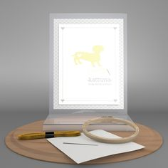 Stitch up this delightful daschund silhouette for a sweet piece to hang up on your doorway.