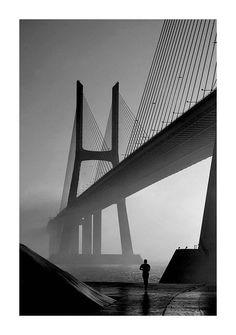 Vasco da Gama bridge, Lisbon, Portugal, on a foggy sunrise.
