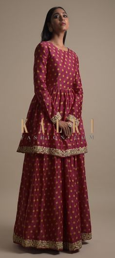 Buy Online from the link below. We ship worldwide (Free Shipping over US$100)  Click Anywhere to Tag Ruby Pink Skirt With Peplum Kurti In Cotton With Printed Floral Buttis Online - Kalki Fashion Ruby pink skirt with peplum kurti in cotton.Adorned with printed floral buttis and zari embroidered border.Crafted with round neckline and full sleeves.