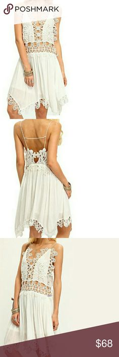Beautiful Embroidered Dress Brand new without tags. A little bit of an off-white color. Loose-flowy fit. Size small however because of the fit.. This can fit a small and a medium.  Offers welcome! Dresses Midi