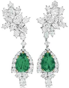 Harry Winston emerald and diamond earrings. Each suspending a detachable pendant, set with a pear-shaped emerald within a pear and circular-cut diamond surround, to the pear and marquise-cut diamond cluster surmount, mounted in platinum and gold
