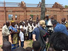 One mother being filmed, telling how important this brick school will be for her baby daughter and her young son and for all the children in the village.