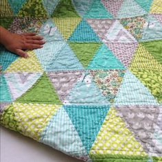 Baby spring triangle quilt on the blog today by filminthefridge, via Flickr