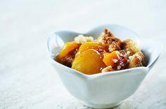 Summer peach cobbler recipe prepared with ripe yellow peaches, lemon, nutmeg, and a crumbled dough topping.