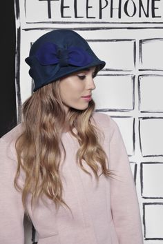 A pop of color with this pretty blue hat.