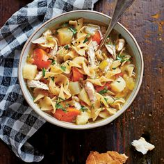 Soulful Chicken Soup | No dish is quite as soothing as a hearty bowl of chicken noodle soup. Slow cookers couldn't have made the road to comfort any easier: Simply toss in the ingredients, switch on, and then walk away. We love old-fashioned, wide egg noodles for this recipe. To make sure they aren't mushy and overcooked, don't leave them in the slow cooker any longer than 10 minutes.