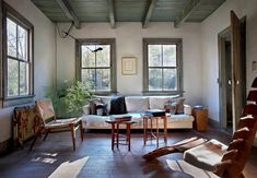 Living room in rustic Hudson Valley farmhouse.