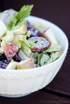 Clean Eating Waldorf Salad (Makes approximately 7 cups) Ingredients:  2 cups chopped apple 2 cups chopped celery 1 cup chopped walnuts 2 cups red grapes, halved 1/4 cup eggless mayo or cashew cream with honey and lemon juice added to taste Directions:  Combine all ingredients together in a large mixing bowl, chill and serve.