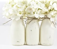 What could be more beautiful than a white shabby chic baby nursery. Use these half pint painted milk bottles for your baby shower