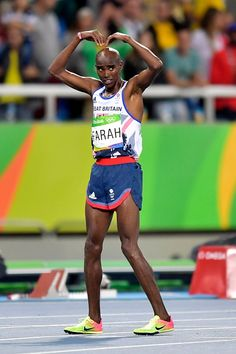Mo Farah of Great Britain celebrates his win at the Men s race at the… 46115f694