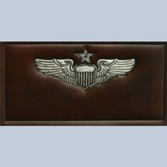 Name tag Air Force Senior Pilot. Embossed on leather and hand painted silver with black outline. Gold emblem on other brown and black leather available. Shown in dark brown leather. 2x4 inches