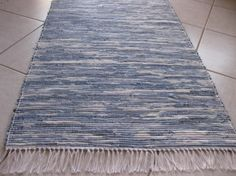 """Beautiful Woven Recycled Denim Rug - Terry Dewal made this rag rug was by cutting old jeans into strips, then weaving them on a floor loom.  """"The rug is long wearing, machine-washable and adds a flare of color and design to any room,"""" he says. A few splashes of Clorox gave them a blotchy, stonewashed appearance"""
