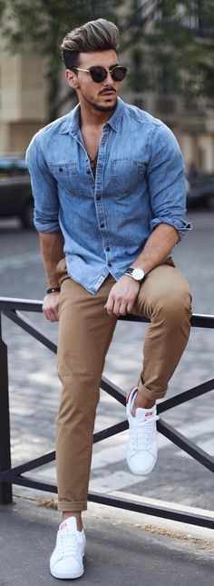 - with a summer outfit idea with a denim button up shirt with rolled up sleeves sunglasses tan chinos no show socks white stan smith adidas sneakers watch wrist accessories Chinos Men Outfit, Tan Chinos, Men Denim Shirt Outfit, Jean Shirt Outfits, Pant Shirt, Blazer Outfits, Mode Masculine, Blue Denim Shirt, Denim Shirts For Men