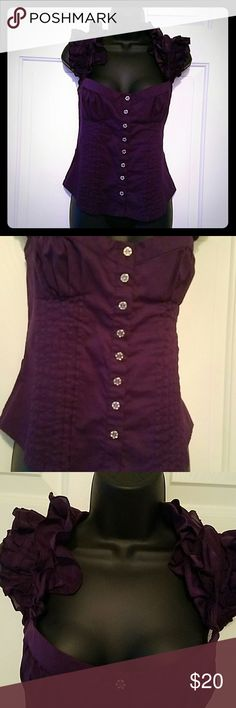 BEBE shirt Authentic BEBE shirt in the color royal purple. Gently used. Has all buttons, no defects.   All clothes should be washed before use  All considerable offers welcomed! Please note that Posh does get a % of what ever is sold.   Ships within 24 hours   NO TRADES. bebe Tops