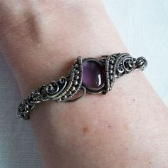 Amethyst cabochon set in sterling silver wire. No solder, no castings, no glue, no torch.
