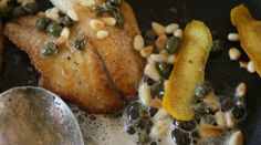 Freshwater fish with butter, pine nuts, tangerine peel and capers.
