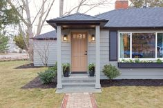 Boise Boys | Timber And Love | Luke Caldwell | HGTV | Realty | Mid Century modern | home renovation | Design | Boise Idaho | gray exterior | front entry | wooden door | black shutters | window box