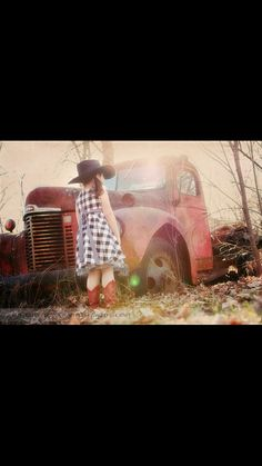 Old rusty red truck photography cowgirl boots hat vintage little girl