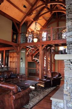 Beautiful custom wrought iron accents on the open tread staircase and catwalk keep the great room bright, open and airy.