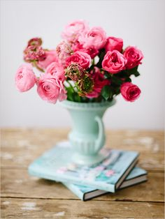Pink flowers in a mint vase.