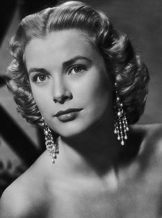 1950s Grace Kelly - softened arches . fronts still heavier and squared off.