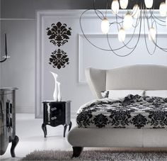 High Quality Black And White Bedroom. Damask Wallpaper. Chandelier. White Elaborate  Carved Bed. Modern White Chair. Silver Side Tables.