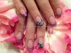 Acrylic nails with pink and purple blended tips and valentine love heart freehand nail art