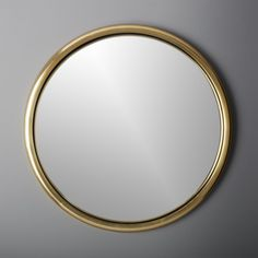 """Shop 25"""" porthole gold round wall mirror.   Classic ship window shines anew in this modern maritime design.  Rounded metallic frame encloses a rounded mirror that reflects a fisheye effect, convex to be precise."""