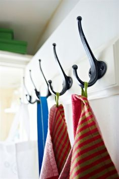 Row of hooks with clothes hanging on them