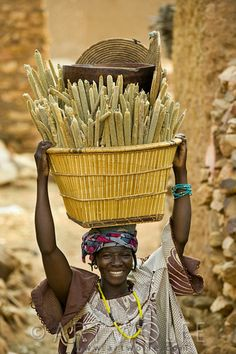 Woman carrying basket of millet, Mopti Region...