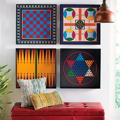 Hang them as graphic art on the wall. Or actually play the iconic board games. Our multi-use Game Board Trays come in graphic colors and are made from sturdy wood with carrying handles. Each game    board is sold separately and comes with its corresponding game pieces packed in a velvet bag. Select Chess