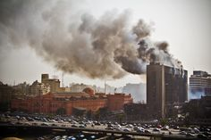 The headquarters of the National Democratic Party, Egypt's ruling political party under Mubarak's rule, burns after being set on fire on January 28, 2011. Photo credit: unkown