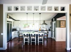 I love the look of this kitchen. It is large enough to feel airy even with the dark walls and appliances.