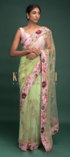 Buy Online from the link below. We ship worldwide (Free Shipping over US$100)  Click Anywhere to Tag Pista Green Saree In Net With Velvet Patch Work In Floral Pattern On The Border Online - Kalki Fashion Pista green saree in net with sequins and zari embroidered floral pattern.It comes with a blush pink border with velvet patchwork, resham and sequins embroidered floral pattern.