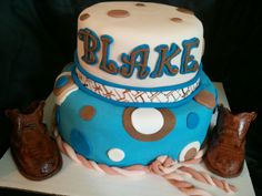 Made by LaKeisha Keck with Sweet Tooth Mother and Daughter cakes.  Baby cowboy boots cake.