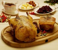 Traditional Danish Christmas dinner: roast goose, rødkål (sweet/sour red cabbage), browned new potatoes.