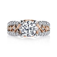 Rose gold playful entwines with this setting's diamond accented lattice filigree. This engagement ring features: Rose Gold Milgrain & Filigree; Intricate Metalwork; Diamond Accent Stones. Shown in Two Tone with a One and Half Carat Round Brilliant Cut; Center excluded from Price. Side stones: 0.70 Carat Total Weight.