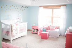 Coral + Aqua Nursery - love the whimsical design of the gold dot wall decals!