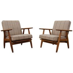 Pair of GE-240 Lounge Chairs by Hans Wegner | From a unique collection of antique and modern lounge chairs at https://www.1stdibs.com/furniture/seating/lounge-chairs/