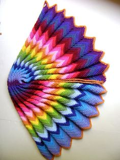 Make a vibrant blanket using the popular chevron design and a plethora of scraps or selected rainbow colors! If you decide to purchase specific yarn, you will have so much leftover, you'll be able to make a couple more blankets. This is an easy pattern that's great for a new crocheter.