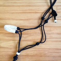 Rope Halter with Fiador Knot and Braided Noseband  Just like favorite clinicians use!      This hand-tied rope horse halter is tied with a fiador knot and double overhand knots – not like the cheater knots seen elsewhere.      Made with 1/4″ inch double braid (soft) polyester rope.       Machine washable.      We can also add a sliding Turks Head knot above the fiador knot to allow for custom sizing of the nose opening.    Buy online at www.justdandybeautique.com! #horse #halter #rope…