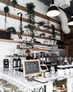 Funky coffee bar, wouldn't have plants on the shelves