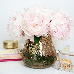 Making beautiful flower arrangements is simple- stick to the same types and/or similar colors.