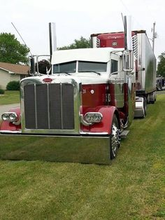 Maroon and white Peterbilt w/reefer. If it isn't cool don't waste your time pinning it!!!