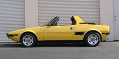 FIAT X1/9 (Bertone design) My first car. I pushed it more miles than I drove it. At least it was light, lol