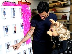 Marc Jacobs and Miss Piggy going over designs